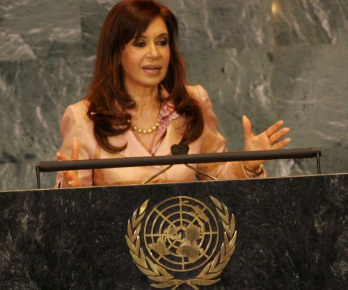 Argentina steps up hunt for former spy; condemns U.S. inaction