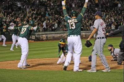 Down to last strike, Oakland As rally to win
