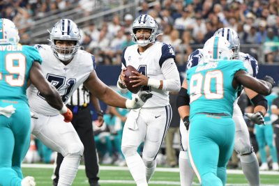 Cowboys overwhelm upset-minded Dolphins with second half barrage