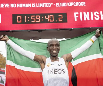 Kenya's Eliud Kipchoge first to break 2-hour marathon barrier