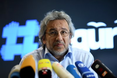 Turkey sentences journalist Can Dundar to 27 years in prison