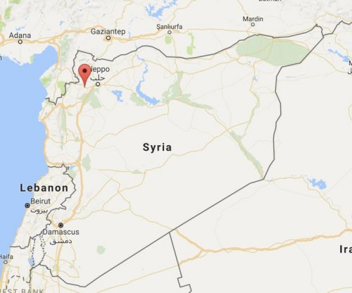 Dozens killed in airstrikes on Syrian market