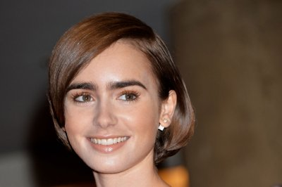 Lilly Collins reportedly dating Chris Evans