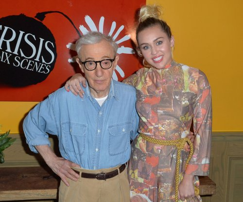 Miley Cyrus defends Woody Allen as 'a really great dad'