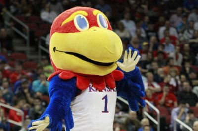 No. 3 Kansas rides frantic finish to OT win over No. 9 West Virginia