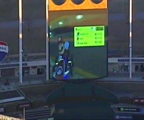Baseball stadium's big screen hosts giant 'Mario Kart' game