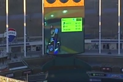 Baseball stadium's big screen hosts giant 'Mario Kart' game