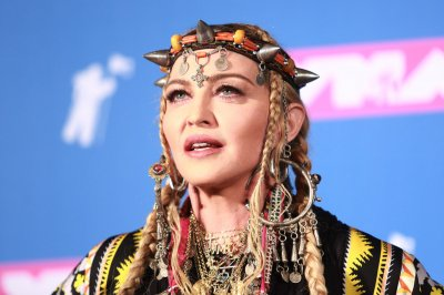 Madonna to direct, co-write her own biopic for Universal
