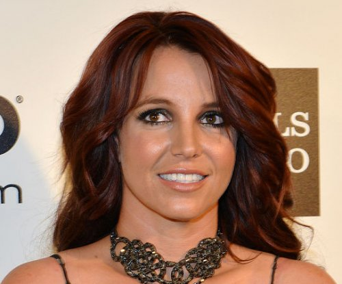 Britney Spears 'ok' after on-stage fall in Las Vegas