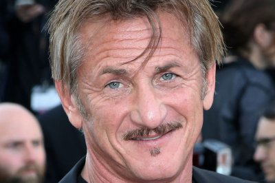 Sean Penn goes public with 24-year-old Leila George