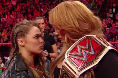 WWE Raw: Rousey, Jax have stare down, Reigns and Rollins team up