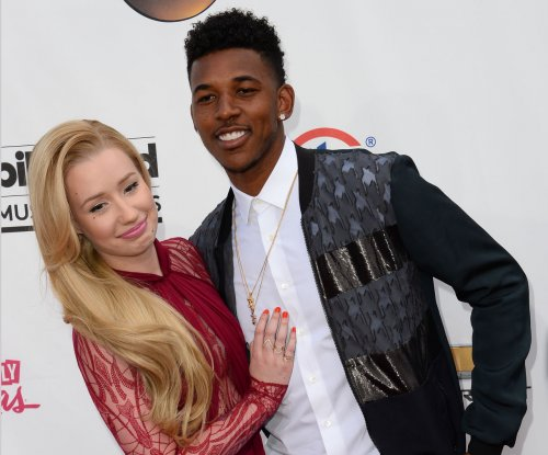 Iggy Azalea and fiance Nick Young postpone wedding