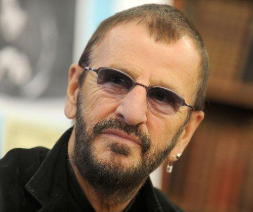Queen Elizabeth knights Ringo Starr, Barry Gibb