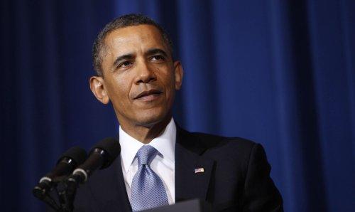 Obama: Economy has 'momentum'
