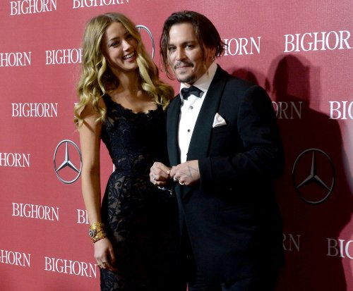 Johnny Depp confirms split from Amber Heard; won't comment on 'salacious false stories'
