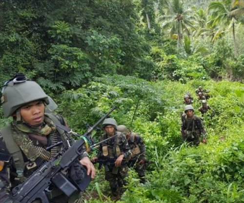 15 Philippine soldiers killed, two beheaded, in clashes with Abu Sayyaf
