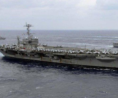 USS George Washington gets its mast, part of four-year overhaul