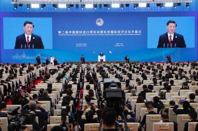 China leader Xi Jinping takes aim at U.S. in free trade speech