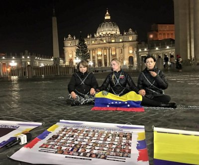 Wives, mother of jailed Venezuelan opposition leaders chained in Vatican protest