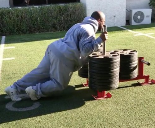 Pittsburgh Steelers' Harrison pushes 1,400-pound sled