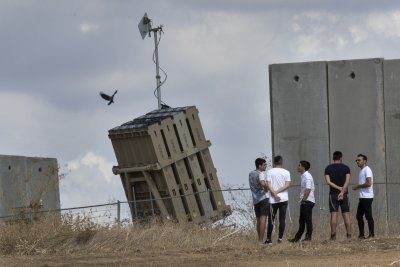 Israel strikes Hamas after rocket launched from Gaza forces Benjamin Netanyahu off stage
