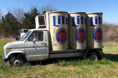 Vintage Miller Lite delivery truck with 6 pack-shaped fridge listed for sale