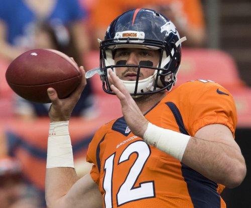 Denver Broncos' Vance Joseph not ruling out drafting a QB