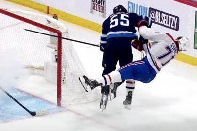 NHL playoffs: Canadiens' Jake Evans stretchered off ice after scoring goal