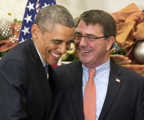 Obama picks ex-Pentagon official to replace Hagel as defense secretary