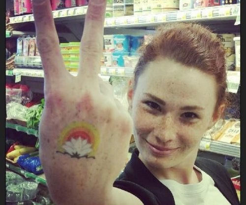 Grocery store offers discounts for customers who get logo tattoos