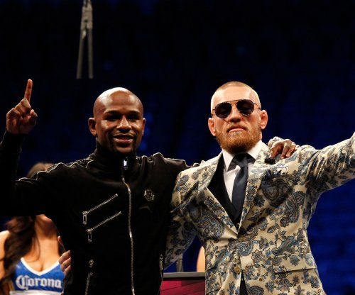 McGregor, Mayweather continue feud, Money teases UFC fight