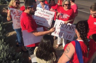Budget earmarks pay raise for Arizona teachers, likely ending strike