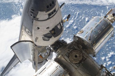 Astronauts install batteries on station