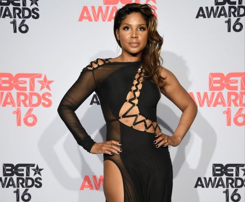 Toni Braxton hospitalized for lupus complications, postpones concert