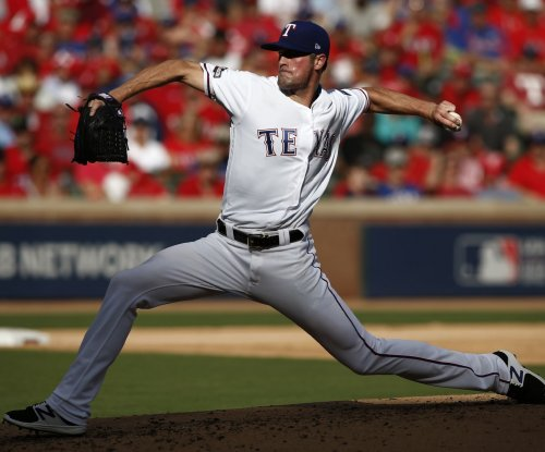 Texas Rangers' Cole Hamels out for eight weeks with oblique strain
