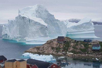 Iceberg nears Greenland village, threatens destructive waves