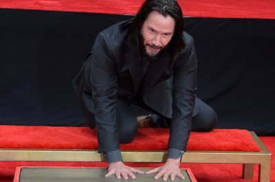 Actor Keanu Reeves' hand and footprints immortalized in front of Chinese Theatre