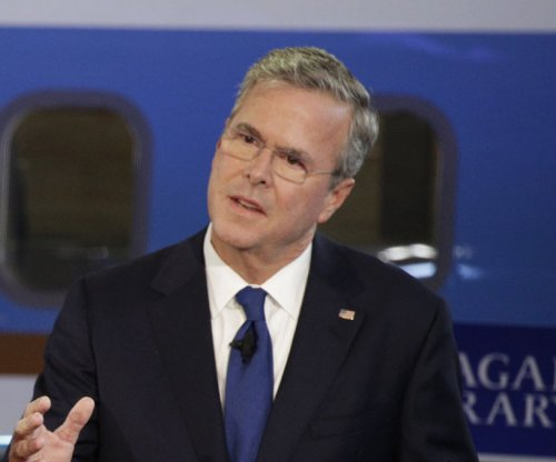 Bush orders pay cuts to keep campaign going