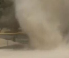 Dust devil sweeps through aftermath of little league game