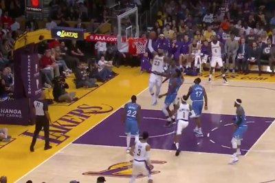 LeBron James loses defender with 360, stuffs slam