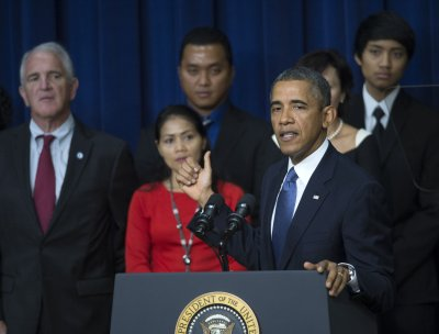 Obama touts economy, slams Republicans