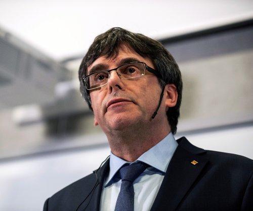 Catalan leaders urge ex-president Puigdemont to end return bid