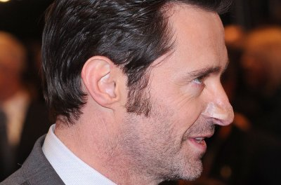 Hugh Jackman sports nose bandage at 'Logan' premiere days after cancer treatment