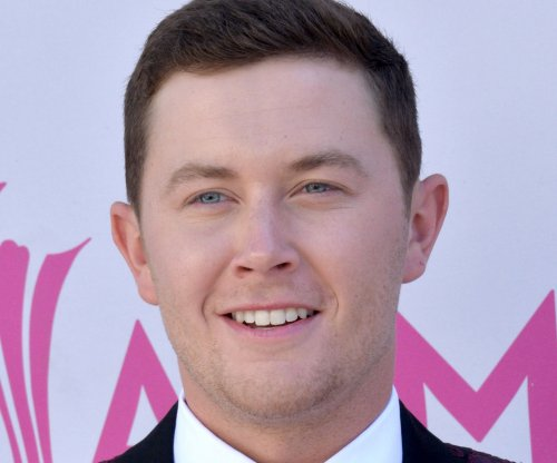 Scotty McCreery says he forgot gun was in the backpack he took to airport