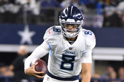 Titans QB Mariota limited, but expects to face Texans