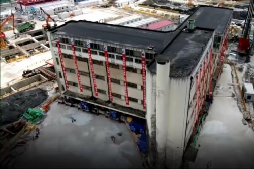 Five-story building 'walks' to new home in China