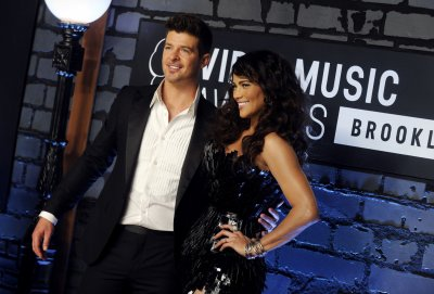 Robin Thicke calls wife Paula 'my rock, my muse, my inspiration'