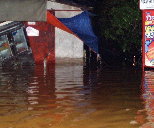 Malaysia's worst flooding in 30 years hampered disaster management response