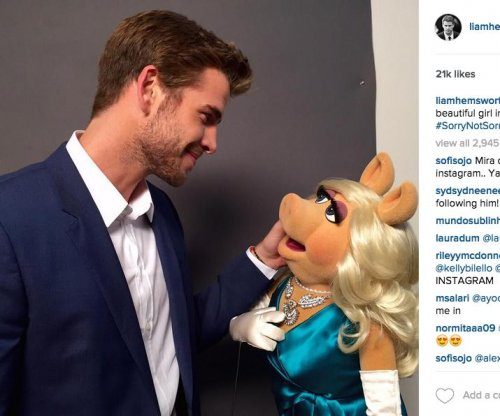 Liam Hemsworth jabs Miss Piggy's ex, Kermit, on Instagram