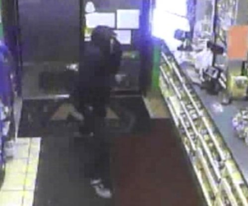 Gas station clerk thwarts holdup with scalding cup of coffee